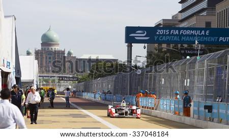 Putrajaya, Malaysia - November 7, 2015 : Bruno Senna of Team Mahindra Racing exits pitlane at FIA Formula-e ePrix Championship Putrajaya, Malaysia - stock photo