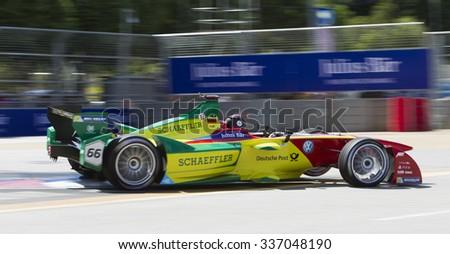 Putrajaya, Malaysia -? November 7, 2015 : German Daniel Abt of Team ABT Schaeffler Audi exits turn 2 at FIA Formula-e ePrix Championship Putrajaya, Malaysia - stock photo