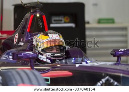Putrajaya, Malaysia - November 7, 2015 : Jean eric Vergne of Team Virgin Racing in deep concentration at FIA Formula-e ePrix Championship Putrajaya, Malaysia - stock photo