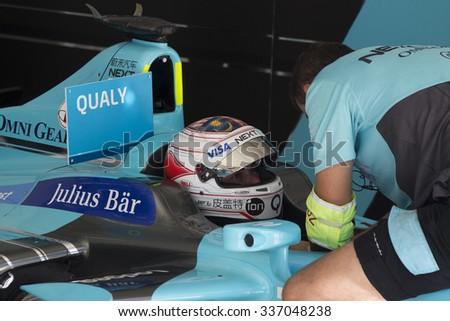 Putrajaya, Malaysia -? November 7, 2015 : Nelson Piquet JR of Team Nextev TCR readies for qualifying at FIA Formula-e ePrix Championship Putrajaya, Malaysia - stock photo
