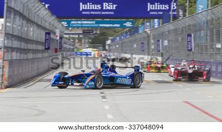 Putrajaya, Malaysia - November 7, 2015 : Netherlands Robin Frijns of Team Amlin Andretti enters turn 1 at FIA Formula-e ePrix Championship Putrajaya, Malaysia. Frijns won third place - stock photo