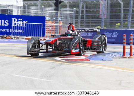 Putrajaya, Malaysia - November 7, 2015 : Stephane Sarrazin of Team Venturi exits turn 2 at FIA Formula-e ePrix Championship Putrajaya, Malaysia - stock photo