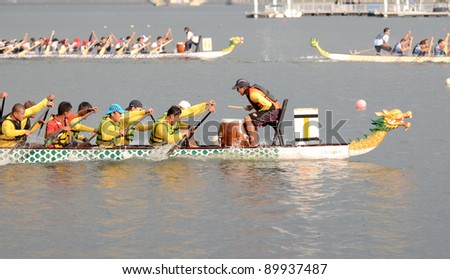 PUTRAJAYA, MALAYSIA-OCT 21: Unidentified team participates in IDBF Cancer Survivors World Cup 2011 & Malaysia International Dragon Boat Festival 2011 on October 21, 2011 at Putrajaya, Malaysia. - stock photo