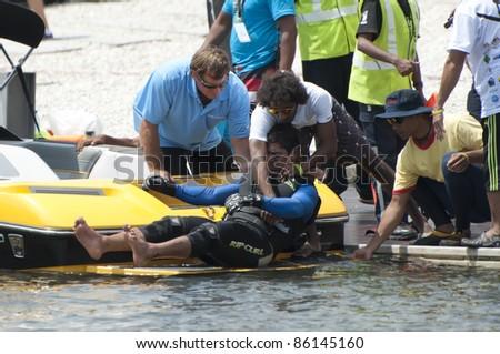 PUTRAJAYA, MALAYSIA - OCTOBER 7: Alzabi Saeed from UAE injured during the jump competition 2011 IWWF Asian Waterski & Wakeboard Championships in Putrajaya, Malaysia on October 7, 2011 - stock photo