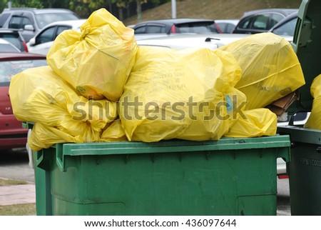 PUTRAJAYA, MALAYSIA -SEPTEMBER 06, 2015: A pile of garbage in the trash - stock photo