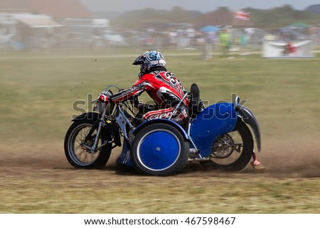 PUTTENHAM, UK - JULY 14: An unnamed sidecar team reach the apex of the top corner of the circuit during the Puttenham grasstrack meeting on July 14, 2013 in Puttenham.