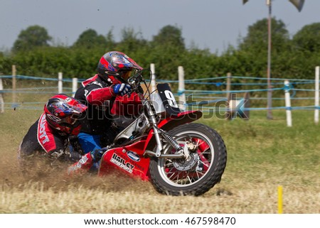 PUTTENHAM, UK - JULY 14: An unnamed sidecar team speed around the top corner of the circuit during the Puttenham grasstrack meeting on July 14, 2013 in Puttenham.