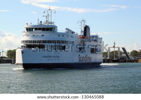 PUTTGARDEN, GERMANY - AUGUST 28: Scandlines ferry leaving Puttgarden harbour on August 28, 2012 in Puttgarden, Germany. Scandlines GmbH, established in 1998, is one of europe's largest ferry companys - stock photo