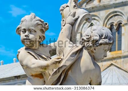 Putti fountain in Piazza dei Miracoli in Pisa, Italy - stock photo