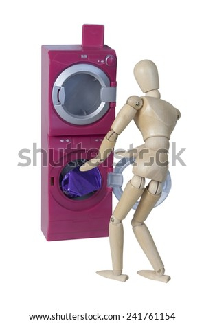 Putting clothes in Washing machine to wash clothes - path included - stock photo