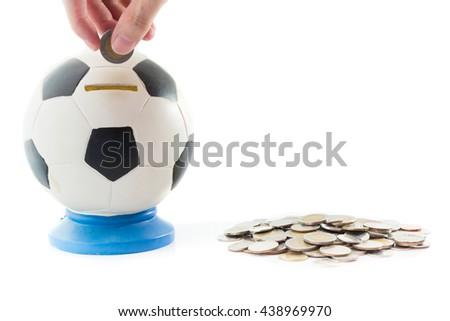 putting coil into saving football money box on white background. concept : saving money, no gamble football euro tournament, no bet  - stock photo