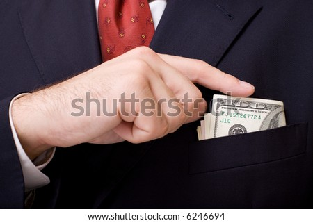 Putting money in boutonniere close up. Business concept. - stock photo