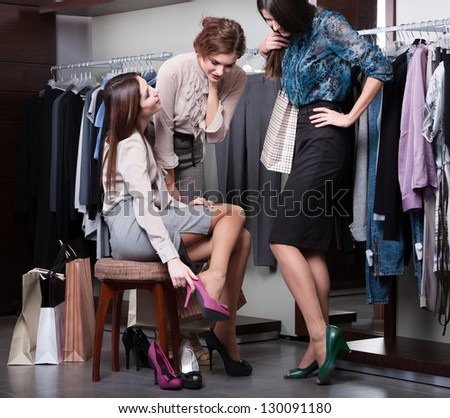Putting on new fuchsia shoes - stock photo
