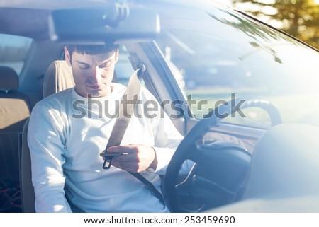 putting on seat belt - stock photo