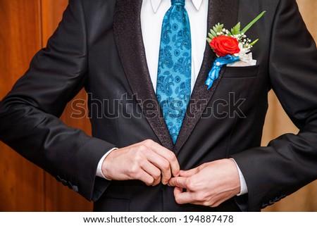 putting on wedding suit  - stock photo