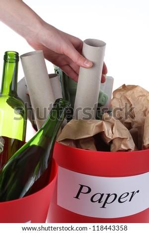Putting paper garbage into recycling bin, closeup - stock photo