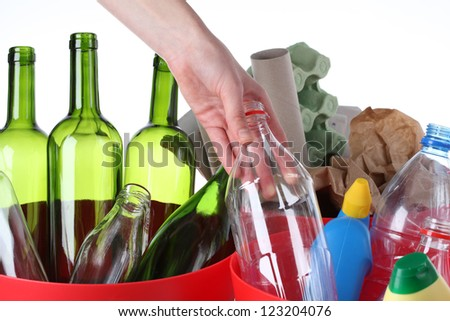 Putting plastic bottle into recycling bin, closeup
