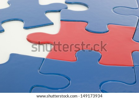 Putting the jigsaw puzzle in teamwork together - stock photo