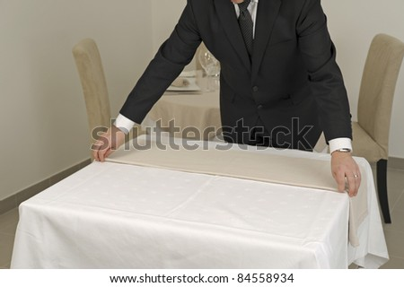 Putting the tablecloth on a square table