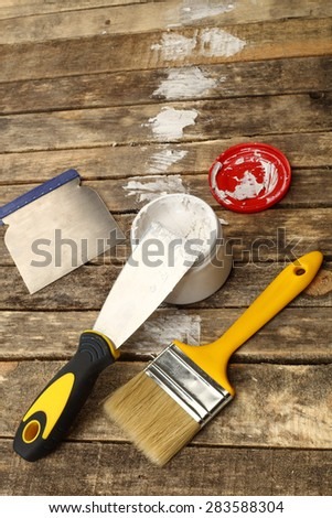 Putty knife with paste close up - stock photo