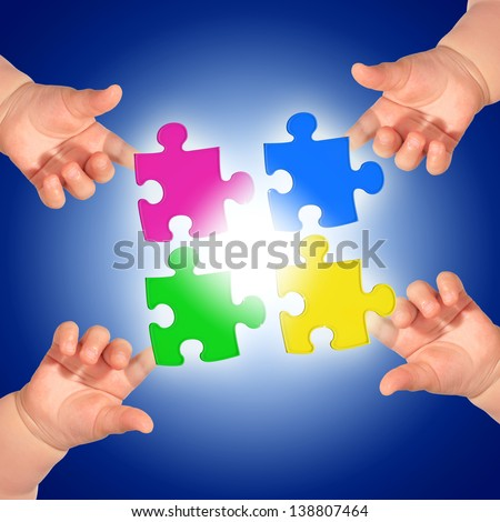 Puzzle and hands over blue background. - stock photo
