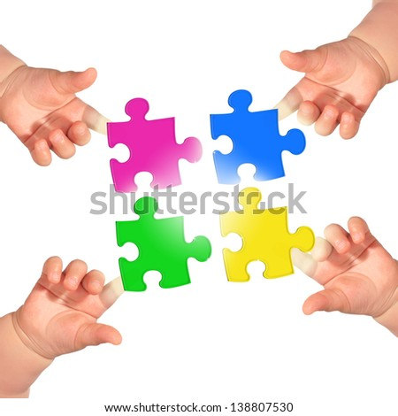 Puzzle and hands over blue background.