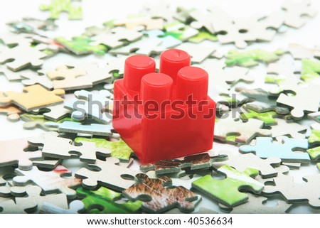 puzzle and one red lego