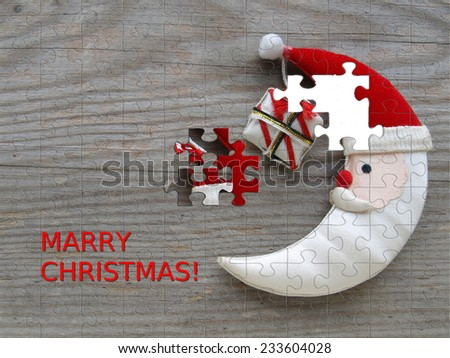 Puzzle - Christmas moon on a wooden board - stock photo