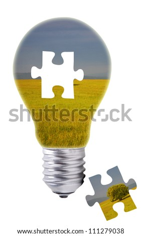 puzzle concept of a light bulb with a green field inside - stock photo