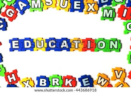 Puzzle education on white background - stock photo