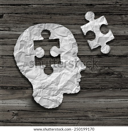 Puzzle head brain concept as a human face profile made from crumpled white paper with a jigsaw piece cut out on a rustic old wood background as a mental health symbol. - stock photo