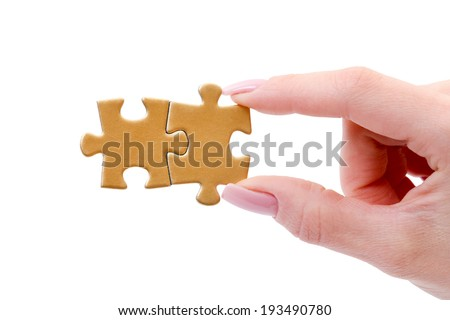 puzzle in hand isolated on white