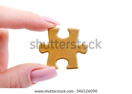 puzzle in hand isolated on white - stock photo