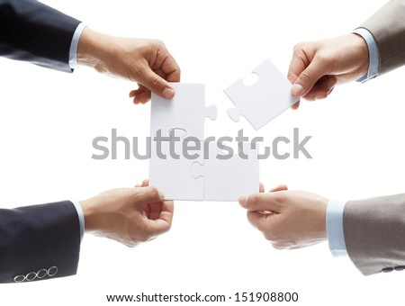puzzle in hands isolated on white background - stock photo