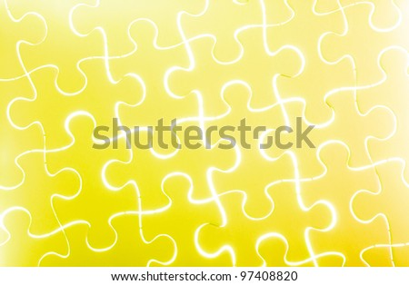 Puzzle in yellow - stock photo