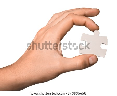 Puzzle. Jigsaw in your hand - stock photo