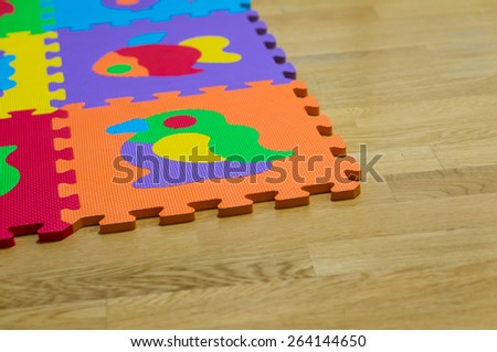 Puzzle mat on the floor - stock photo