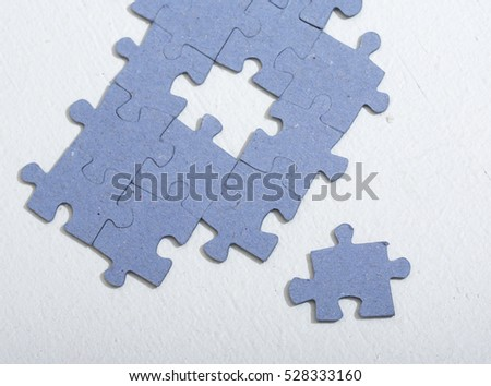 Puzzle on a white table.