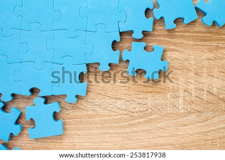Puzzle on wooden background.Team business concept - stock photo