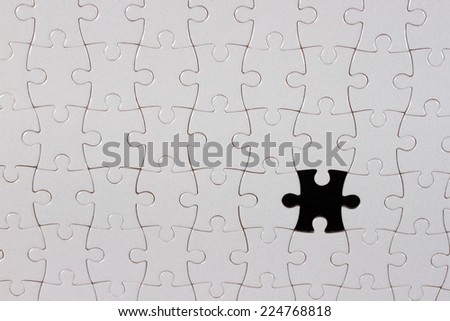 Puzzle piece on black background,the missing piece - stock photo