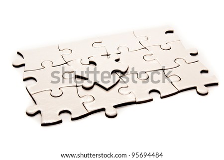 puzzle pieces isolated on a white background - stock photo
