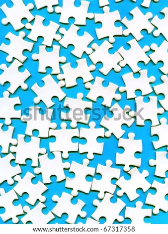 puzzle pieces on a blue background - stock photo