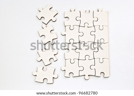 puzzle pieces on a grey background - stock photo