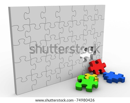 Puzzle wall with colored pieces. Isolated on white.