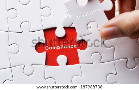 Puzzle with Compliance - stock photo