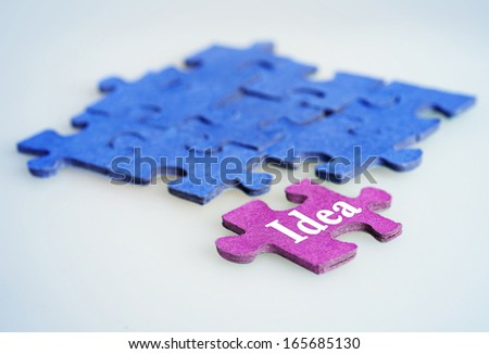 Puzzle with Idea word piece - stock photo