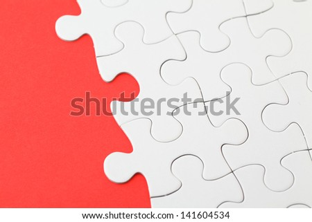 Puzzle with missing part on red background - stock photo