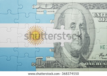 puzzle with the national flag of argentina and dollar banknote . concept