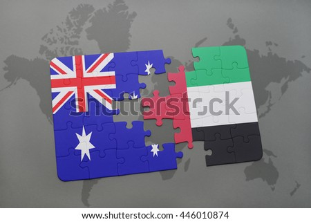 puzzle with the national flag of australia and united arab emirates on a world map background.3D illustration - stock photo