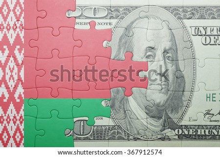 puzzle with the national flag of belarus and dollar banknote . concept
